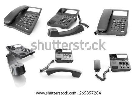 Collection of black office phones isolated on white - stock photo
