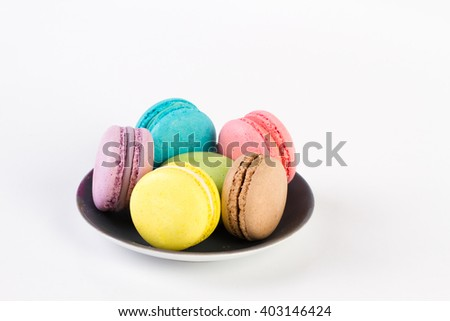Collection of brightly colored French macaroon on the plate