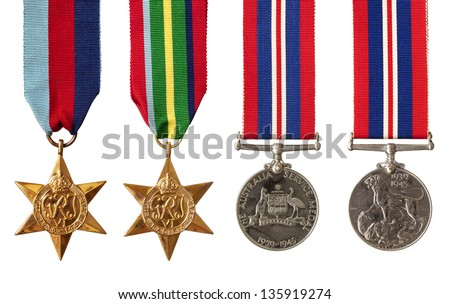 Collection of British and Australian World War II military medals, isolated on white.  Includes the 1939-1945 Star, the Pacific Star, and the Australian and British Service Medals. - stock photo