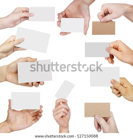 Collection of Business cards in a hand isolated on white - stock photo