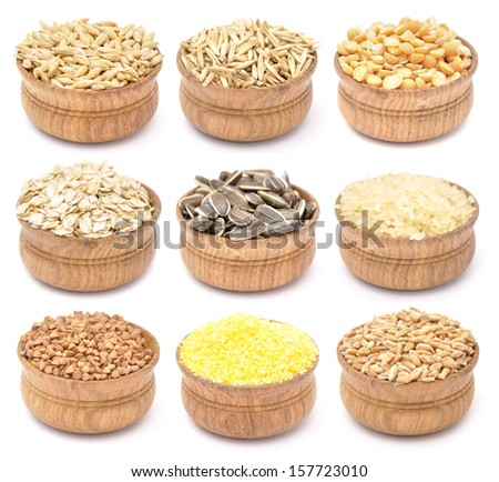 Collection of cereals and grains in wooden bowls - stock photo