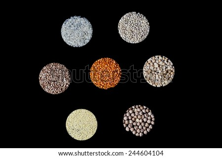 Collection of cereals and legumes on a black background - stock photo
