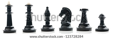 Collection of chess pieces isolated on white. Image was made up of several photo. - stock photo