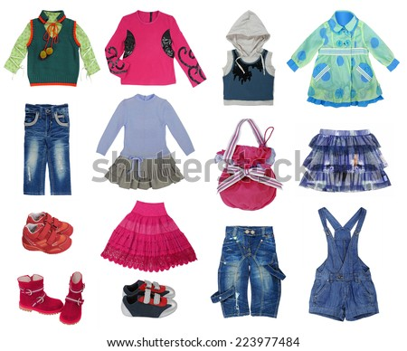 collection of children's clothes isolated on white - stock photo
