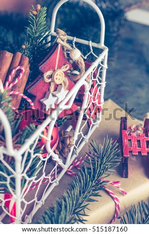 Collection of Christmas decorations and toys on the Christmas tree, fir tree - wooden toys, candy cane, cinnamon. Christmas concept