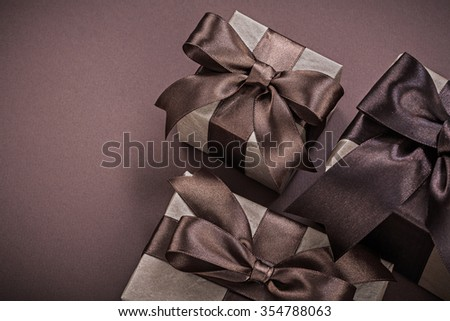 Collection of Christmas present boxes on brown surface holidays concept.