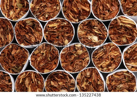 Collection of cigarettes forming a background with copy space