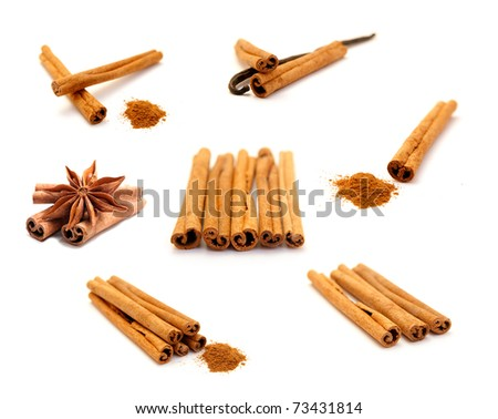 collection of cinnamon sticks isolated on white - stock photo