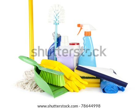Collection of cleaning products and tools on white background