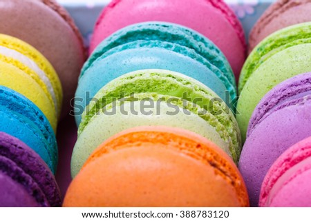 collection of colorful French macarons are next to each other on a white background