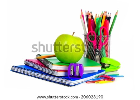 Collection of colorful school supplies over a white background - stock photo