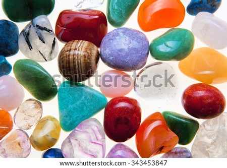 Collection of Colorful Semiprecious Gemstones on White.