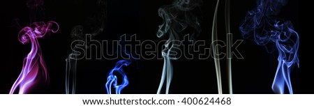 collection of colorful smoke isolated on black background.
