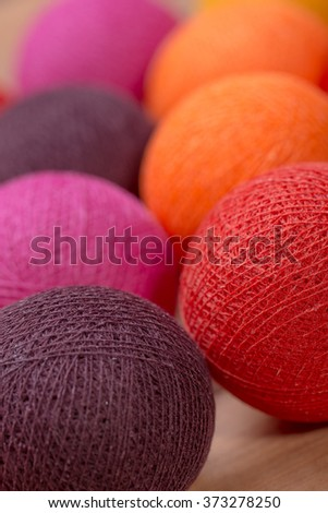 collection of colourful wool balls on white background