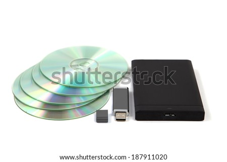 Collection of computer data storage devices: usb memory stick, portable hard disc and cd-rom - stock photo