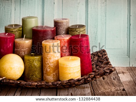 collection of decorative candles on a rustic antique wooden background - stock photo