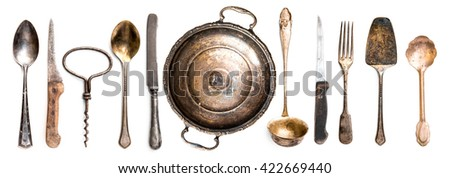 Collection of different antique kitchen utensils on white background - stock photo