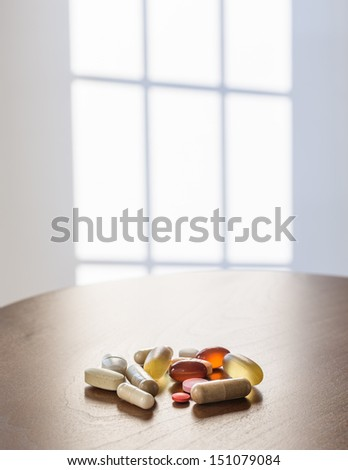 Collection of different colors and sizes of vitamins and supplements taken with breakfast for healthy lifestyle - stock photo