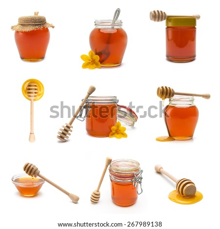 collection of different honey jars and honey dippers on white background - stock photo