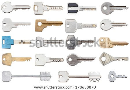 collection of different house keys isolated on white background - stock photo
