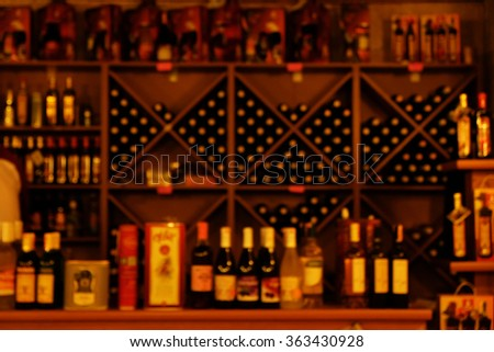 Collection of different kinds of wine in bar - stock photo