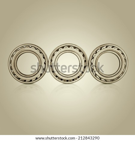 Collection of different steel chromed shiny ball roller bearings on  retro vintage background with reflection effect, closeup - stock photo