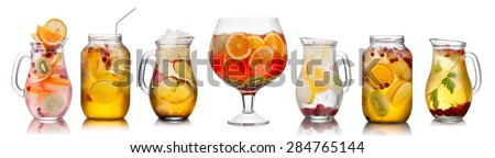 Collection of different summer party drinks in bulk glasses. Pitchers,jugs and jars filled with sangria,spritzers,detox and infused waters. - stock photo