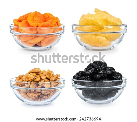 collection of dried fruit in a glass bowl on a white background - stock photo