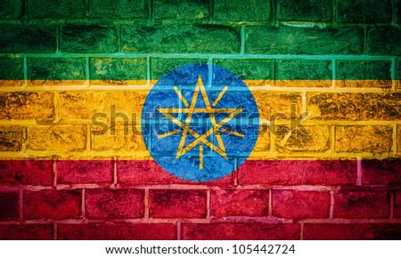 Collection of european flag on old brick wall texture background, ethiopia - stock photo