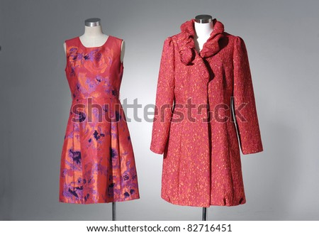 collection of females red dress on mannequin - stock photo