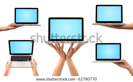 Collection of five laptops on white background - stock photo