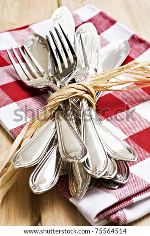 Collection of forks and knifes tied together - stock photo