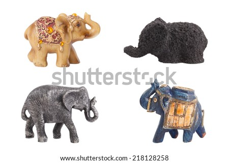 Collection of four ceramic elephants isolated on white background  - stock photo