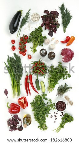 Collection of fresh green vegetables on white background, eggplant, parsley, white beans, tomatoes, parsley, beets, peppers, garlic, onions, cucumbers, red beans, thyme, salt, cabbage - stock photo
