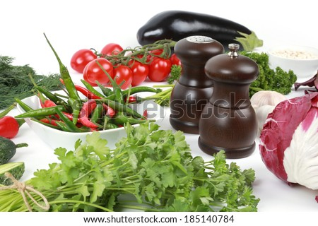 Collection of fresh vegetables on white background, eggplant, parsley, white beans, tomatoes, parsley, peppers, garlic, onions, thyme, salt, cabbage, beets - stock photo