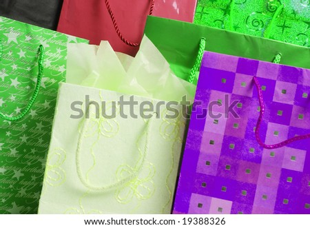 Collection of gift bags in different colors and patterns. - stock photo