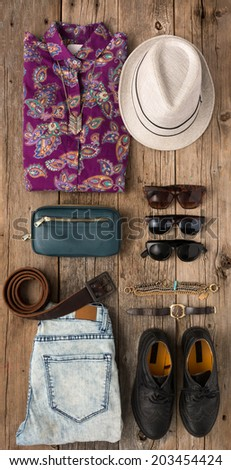 Collection of hip woman's summer clothing shot from above - stock photo