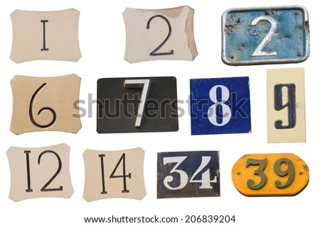 Collection of House numbers on the wall - stock photo