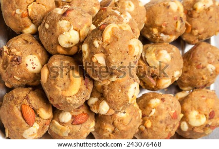 Collection of indian homemade  laddoo (sweet) made of roasted dry fruits wheat flour , edible oil , almonds and Cashew