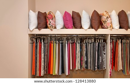 Collection of interior decorative pillows and upholstery textile - stock photo