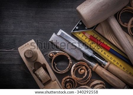 Collection of joiner tools on wood board construction concept. - stock photo