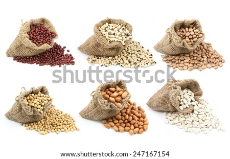 collection of legumes in canvas sack isolated on white background - stock photo