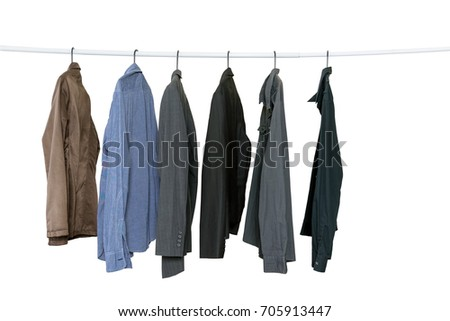 Collection of men's long sleeve shirts hanging on the clothes line isolated on white background with clipping path, lifestyle, beauty and fashion concept.