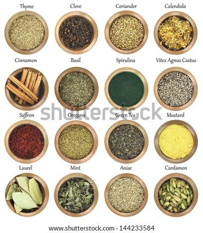 Collection of metal bowls full of herbs and spices - stock photo