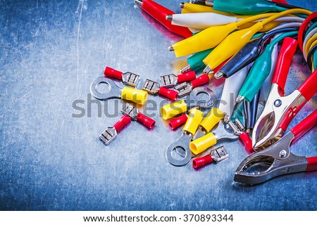 Collection of multicolored crocodile plugs electrical connectors electricity concept. - stock photo