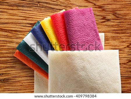 Collection of new colorful paper table napkins - stock photo