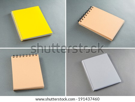 Collection of notebooks on a gray background - stock photo