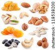 Collection of nuts and dried fruits isolated on the white background, closeup - stock photo
