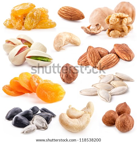 Collection of nuts and dried fruits isolated on the white background, closeup