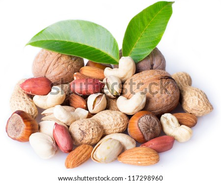collection of nuts with leaves isolated on white - stock photo